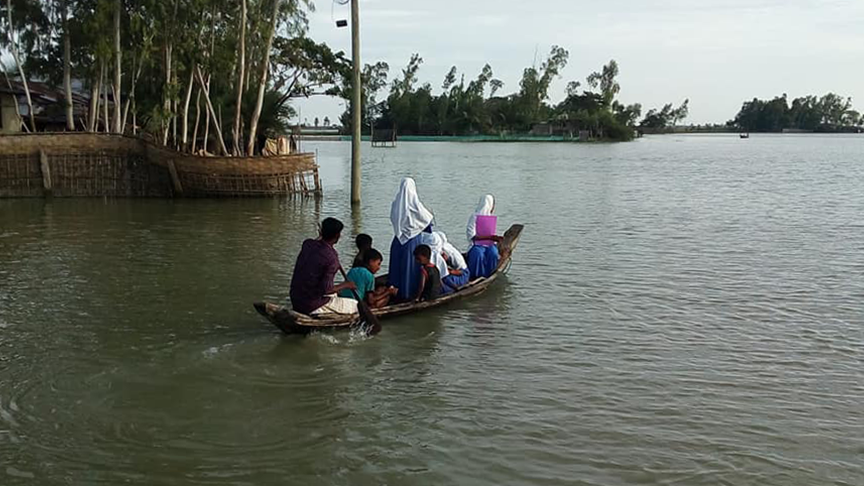 Children are forced to commute to school on small boats because of water logging due to the construction of Matarbari Phase 1. Note the lack of safety gear or life jackets. Photo Credit: CLEAN (Coastal Livelihood and Environmental Action Network) Bangladesh